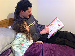 5 year old Aurora is fascinated listening to her dad read Grow Me Well